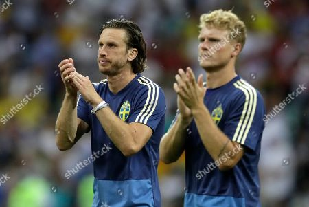 Sweden's Oscar Hiljemark and Gustav Svensson applaud after losing the group F match between Germany and Sweden at the 2018 soccer World Cup in the Fisht Stadium in Sochi, Russia