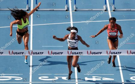Keni Harrison, Queen Harrison, Christina Manning. Keni Harrison, center, crosses the finish line ahead of Queen Harrison, left, and Christina Manning, right, while winning the women's 100-meter hurdles final at the U.S. Championships athletics meet, in Des Moines, Iowa