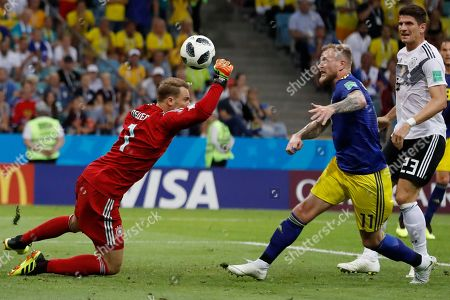 Germany goalkeeper Manuel Neuer blocks a shot from Sweden's John Guidetti during the group F match between Germany and Sweden at the 2018 soccer World Cup in the Fisht Stadium in Sochi, Russia