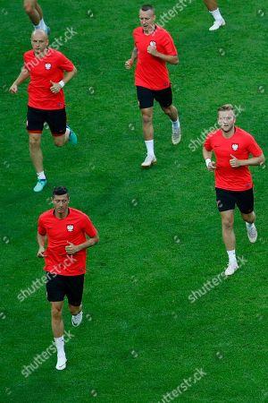 Polish national soccer team players Robert Lewandowski (bottom L), Michal Pazdan (top L), Jacek Goralski (top R), and Jakub Blaszczykowski (R)  during a training session at the Kazan Arena stadium in Kazan, Russia, 23 June 2018. Poland will face Columbia in a group H match of the FIFA World Cup 2018 on 24 June 2018 in Kazan.