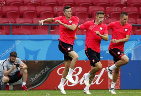 Poland national team players Robert Lewandowski (C), Jan Bendarek (2-nd R) and Artur Jedrzejczyk (R) during a training session at the Kazan Arena stadium in Kazan, Russian Federation, 23 June 2018. Poland will face Colombia in the FIFA World Cup 2018 Group H preliminary round soccer match  on 24 June 2018.