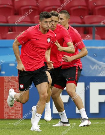 Poland national team players Robert Lewandowski (L), Jan Bendarek (C) and Artur Jedrzejczyk (R) during a training session at the Kazan Arena stadium in Kazan, Russian Federation, 23 June 2018. Poland will face Colombia in the FIFA World Cup 2018 Group H preliminary round soccer match  on 24 June 2018.
