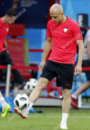 Poland's player Michal Pazdan attends a training session at the Kazan Arena stadium in Kazan, Russian Federation, 23 June 2018. Poland will face Colombia in the FIFA World Cup 2018 Group H preliminary round soccer match  on 24 June 2018.