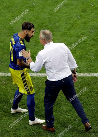 Sweden's head coach Janne Andersson, right, converses with player Jimmy Durmaz during the group F match between Germany and Sweden at the 2018 soccer World Cup in the Fisht Stadium in Sochi, Russia