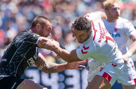 Stock Picture of Sam Burgess fends off New Zealand's Jared Waerea Hargreaves.