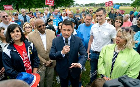 Former Rep. Michael Grimm speaks as he attends a property tax protest rally in the Staten Island borough of New York, . Grimm is opposing incumbent Dan Donovan, R-N.Y., for the Republican Congressional primary for the 11th Congressional District