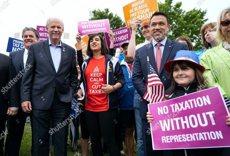 Incumbent Rep. Dan Donovan, R-N.Y., center left, and former Rep. Michael Grimm, center right, attend a property tax protest rally with New York State Assembly member Nicole Malliotakis, R-Staten Island, center, in the Staten Island borough of New York, . Grimm and Donavan are running against one another in the Republican Congressional primary for the 11th Congressional District