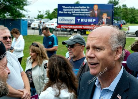Incumbent Rep. Dan Donovan, R-N.Y., right, speaks to supporters and participants as he attends a property tax protest rally in the Staten Island borough of New York, . Donavan is running against former Rep. Michael Grimm in the Republican Congressional primary for the 11th Congressional District