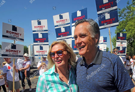 Mitt and Ann Romney walk in the Strawberry Day Parade, in Pleasant Grove, Utah. Romney is flashing his familiar smile at city parks and backyards in Utah's mountains and suburbs this week, making his final pitch after being forced into a Republican primary against a conservative state lawmaker. At stake is being the party's representative to vie for the Senate seat long held by retiring Republican Sen. Orrin Hatch