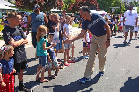 Mitt and Ann Romney. Mitt Romney greets children in the Strawberry Day Parade, in Pleasant Grove, Utah. Romney is flashing his familiar smile at city parks and backyards in Utah's mountains and suburbs this week, making his final pitch after being forced into a Republican primary against a conservative state lawmaker. At stake is being the party's representative to vie for the Senate seat long held by retiring Republican Sen. Orrin Hatch
