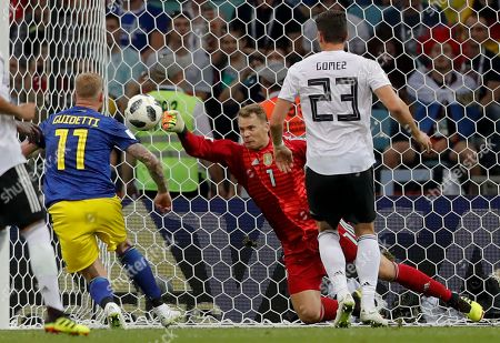 Germany goalkeeper Manuel Neuer, center saves between Sweden's John Guidetti, left, and Germany's Mario Gomez during the group F match between Germany and Sweden at the 2018 soccer World Cup in the Fisht Stadium in Sochi, Russia