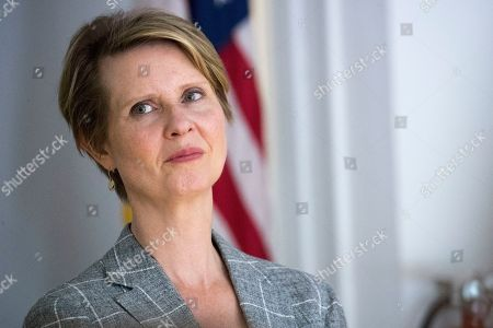 "Democratic candidate for governor Cynthia Nixon looks at the crowd as she introduced during a campaign event at Borough of Manhattan Community College in New York. Nixon has announced that her 21-year-old son Seph Mozes has come out as transgender. The former ""Sex and the City"" star posted the announcement on her Instagram account on Friday, June 22 to mark the 14th annual Trans Day of Action. Nixon is challenging Gov. Andrew Cuomo in New York's Democratic primary for governor"