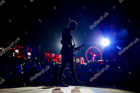 Bass player of British rock band Muse, Christopher Wolstenholme, performs on the World Stage at the 8th edition of Rock in Rio Lisbon, at Parque da Bela Vista in Lisbon, Portugal, 23 June 2018. British rock band Muse are tonight's headliners. The festival runs on June 23, 24, 29 and 30.