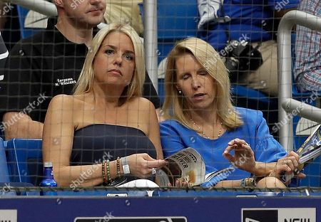 Florida Attorney General Pam Bondi, left, during the third inning of a baseball game between the Tampa Bay Rays and the New York Yankees, in St. Petersburg, Fla