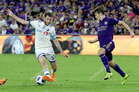Stock Photo of Montreal Impact's Ignacio Piatti, left, moves the ball past Orlando City's Jonathan Spector (2) during the second half of an MLS soccer match, in Orlando, Fla