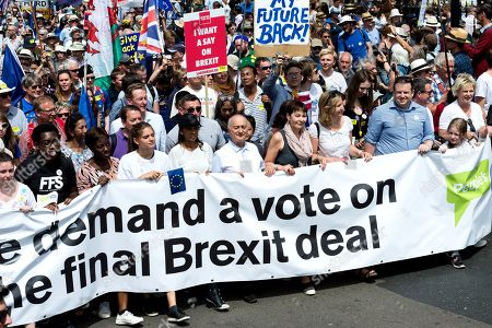 Anti-Brexit campaigner Gina Miller, actor Sir Tony Robinson, Green Party leader Caroline Lucas and Conservative Party MP Anna Soubry joined one hundred thousand of anti-Brexit supporters taking part in People's Vote march in central London followed by a rally in Parliament Square on a second anniversary of the Brexit referendum. Demonstrators demand that the final terms of the Brexit deal negotiated by the government are put before British citizens in a public vote.