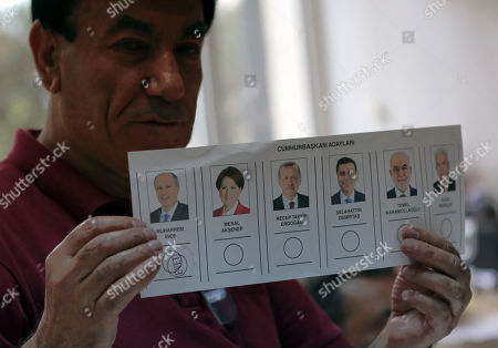 A vote for Muharrem Ince, the candidate of Turkey's main opposition Republican People's Party, is counted at a polling station in Ankara, Turkey, . The polls have closed in Sunday's Turkish landmark presidential and parliamentary elections where President Recep Tayyip Erdogan is seeking re-election to a presidency with vastly expanded powers