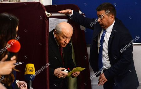 Devlet Bahceli, the leader of the Nationalist Movement Party (MHP) casts his vote for the Turkish presidential and parliamentary elections in Ankara, Turkey, 24 June 2018.    56.3 million registered citizens will vote in snap presidential and parliamentary elections to elect 600 lawmakers and the country's president, the first election since the Turkish people in a referendum in April 2017 voted to change the country's system from a parliamentary to a presidential republic.