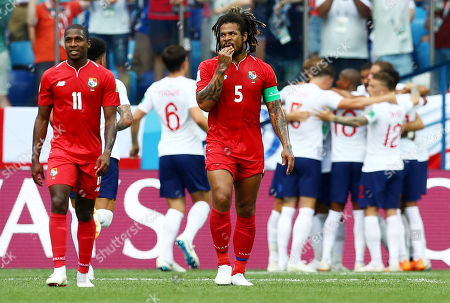 Roman Torres and Armando Cooper of Panama look dejected after their side concede a fourth goal.