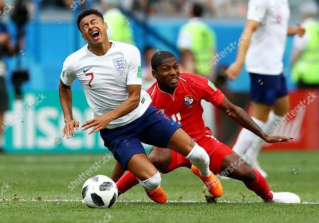 Jesse Lingard of England is tackled by Armando Cooper of Panama.