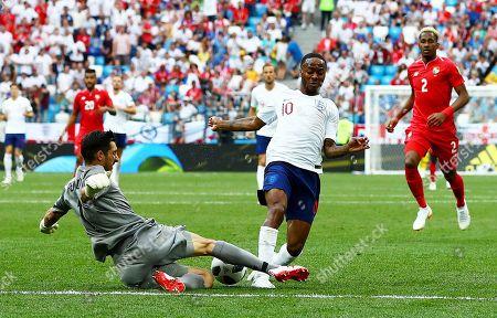 Raheem Sterling of England is tackled by Jaime Penedo of Panama.