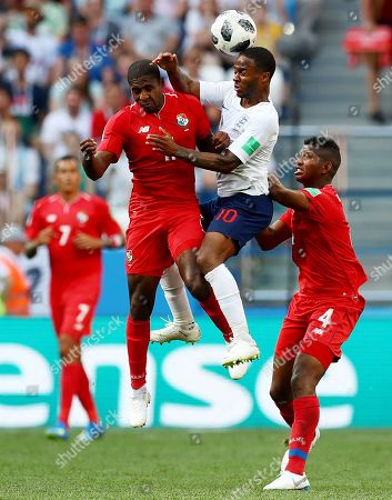 Raheem Sterling of England and Armando Cooper of Panama.