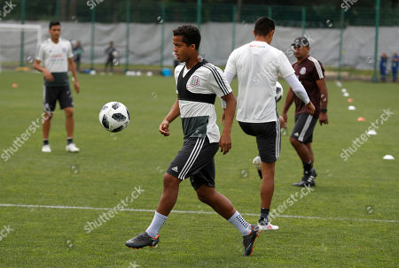 Mexico's Giovani Dos Santos control the ball during a training session of Mexico at the 2018 soccer World Cup in Moscow, Russia