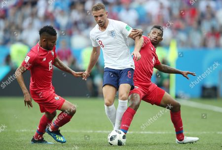 Jordan Henderson of England tackled by Erick Davis of Panama and Fidel Escobar