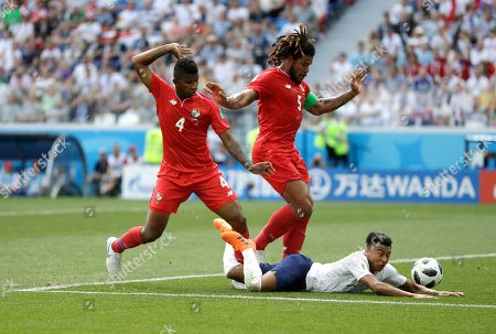 England's Jesse Lingard falls as he is fouled by Panama's Fidel Escobar, left, as Roman Torres watches during the group G match between England and Panama at the 2018 soccer World Cup at the Nizhny Novgorod Stadium in Nizhny Novgorod, Russia