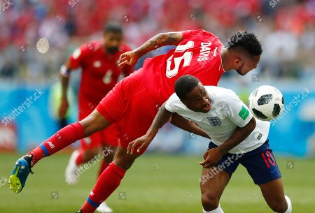 Panama's Eric Davis heads the ball away from England's Raheem Sterling during the group G match between England and Panama at the 2018 soccer World Cup at the Nizhny Novgorod Stadium in Nizhny Novgorod, Russia
