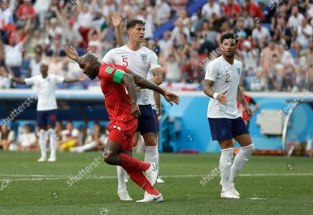 Panama's Felipe Baloy, left, reacts after scoring his team's first goal as England's John Stones and Kyle Walker, right, watch during the group G match between England and Panama at the 2018 soccer World Cup at the Nizhny Novgorod Stadium in Nizhny Novgorod, Russia