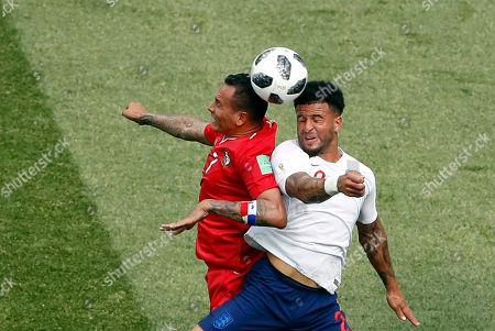 Panama's Blas Perez, left, vies for the ball with England's Kyle Walker during the group G match between England and Panama at the 2018 soccer World Cup at the Nizhny Novgorod Stadium in Nizhny Novgorod, Russia