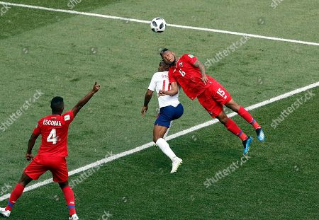 Panama's Eric Davis, right, vies for the ball with England's Raheem Sterling, middle, as teammate Fidel Escobar reacts during the group G match between England and Panama at the 2018 soccer World Cup at the Nizhny Novgorod Stadium in Nizhny Novgorod, Russia