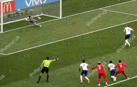 England's Harry Kane, top right, scores past Panama goalkeeper Jaime Penedo, his first penalty during the group G match between England and Panama at the 2018 soccer World Cup at the Nizhny Novgorod Stadium in Nizhny Novgorod, Russia
