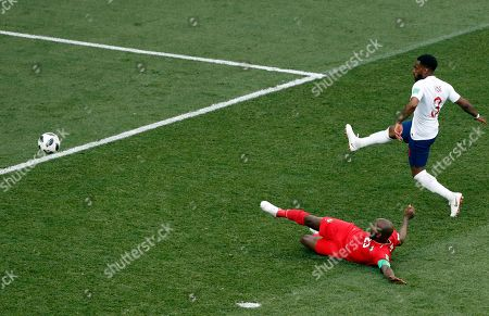 Panama' Felipe Baloy, left, scores his site's first goal as England's Danny Rose watches on during the group G match between England and Panama at the 2018 soccer World Cup at the Nizhny Novgorod Stadium in Nizhny Novgorod, Russia
