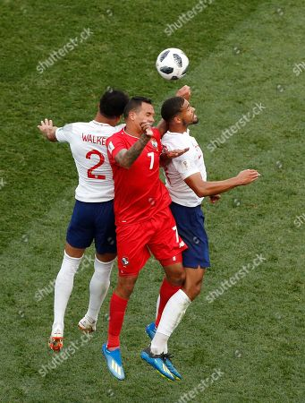 England's Panama's Blas Perez, middle, with England's Ruben Loftus-Cheek, right, jump for the ball during the group G match between England and Panama at the 2018 soccer World Cup at the Nizhny Novgorod Stadium in Nizhny Novgorod, Russia