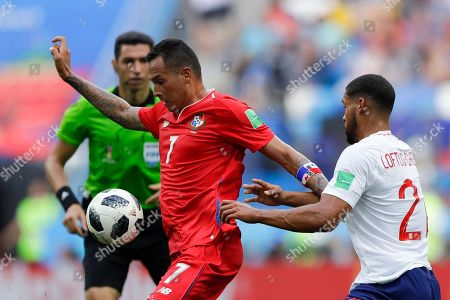 Panama's Blas Perez, left, and England's Ruben Loftus-Cheek challenge for the ball during the group G match between England and Panama at the 2018 soccer World Cup at the Nizhny Novgorod Stadium in Nizhny Novgorod, Russia