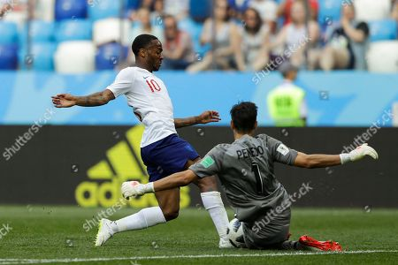 England's Raheem Sterling, left, is blocked by Panama goalkeeper Jaime Penedo during the group G match between England and Panama at the 2018 soccer World Cup at the Nizhny Novgorod Stadium in Nizhny Novgorod, Russia