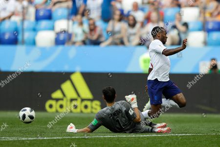 England's Raheem Sterling, right, is blocked by Panama goalkeeper Jaime Penedo during the group G match between England and Panama at the 2018 soccer World Cup at the Nizhny Novgorod Stadium in Nizhny Novgorod, Russia