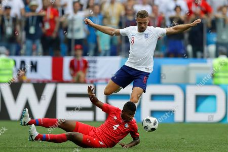 England's Jordan Henderson, top, and Panama's Fidel Escobar, challenge for the ball during the group G match between England and Panama at the 2018 soccer World Cup at the Nizhny Novgorod Stadium in Nizhny Novgorod, Russia