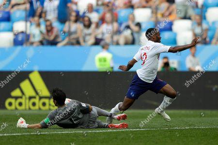 England's Raheem Sterling, right, tumbles over Panama goalkeeper Jaime Penedo during the group G match between England and Panama at the 2018 soccer World Cup at the Nizhny Novgorod Stadium in Nizhny Novgorod, Russia