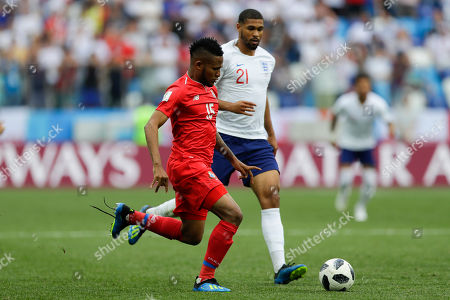 Panama's Eric Davis, left, and England's Ruben Loftus-Cheek challenge for the ball during the group G match between England and Panama at the 2018 soccer World Cup at the Nizhny Novgorod Stadium in Nizhny Novgorod, Russia