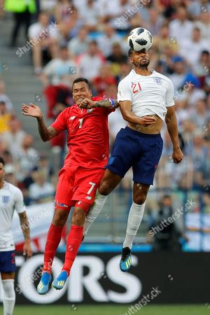 England's Ruben Loftus-Cheek, right, and Panama's Blas Perez challenge for the ball during the group G match between England and Panama at the 2018 soccer World Cup at the Nizhny Novgorod Stadium in Nizhny Novgorod, Russia