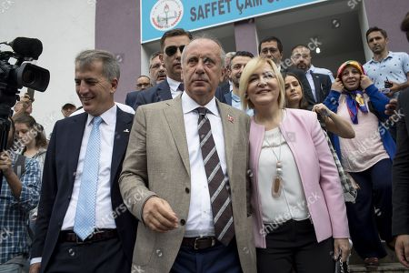 Muharrem Ince, presidential runner of the main opposition Republican People's Party (CHP) and his wife Ulku leave the voting station in their hometown, 50 km from Istanbul. The candidate of the social-democratic party, founded by Mustafa Kemal Ataturk, stands for snap presidential elections, facing with four other opponents to Recep Tayyip Erdogan. His approval rating has been soaring all along his campaign, becoming a real danger for the outgoing president.