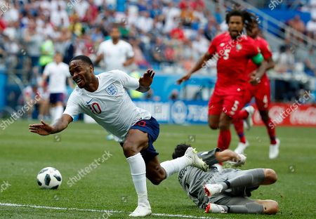 Goalkeeper Jaime Penedo (down) of Panama and Raheem Sterling of England in action during the FIFA World Cup 2018 group G preliminary round soccer match between England and Panama in Nizhny Novgorod, Russia, 24 June 2018. (RESTRICTIONS APPLY: Editorial Use Only, not used in association with any commercial entity - Images must not be used in any form of alert service or push service of any kind including via mobile alert services, downloads to mobile devices or MMS messaging - Images must appear as still images and must not emulate match action video footage - No alteration is made to, and no text or image is superimposed over, any published image which: (a) intentionally obscures or removes a sponsor identification image; or (b) adds or overlays the commercial identification of any third party which is not officially associated with the FIFA World Cup)