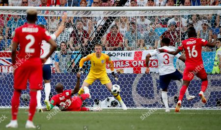 Felipe Baloy (down) of Panama scores a goal during the FIFA World Cup 2018 group G preliminary round soccer match between England and Panama in Nizhny Novgorod, Russia, 24 June 2018. (RESTRICTIONS APPLY: Editorial Use Only, not used in association with any commercial entity - Images must not be used in any form of alert service or push service of any kind including via mobile alert services, downloads to mobile devices or MMS messaging - Images must appear as still images and must not emulate match action video footage - No alteration is made to, and no text or image is superimposed over, any published image which: (a) intentionally obscures or removes a sponsor identification image; or (b) adds or overlays the commercial identification of any third party which is not officially associated with the FIFA World Cup)