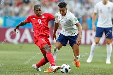 Panama's Armando Cooper, left, and England's Jesse Lingard fight for the ball during the group G match between England and Panama at the 2018 soccer World Cup at the Nizhny Novgorod Stadium in Nizhny Novgorod, Russia