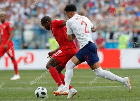 Panama's Armando Cooper, left, and England's Kyle Walker fight for the ball during the group G match between England and Panama at the 2018 soccer World Cup at the Nizhny Novgorod Stadium in Nizhny Novgorod, Russia