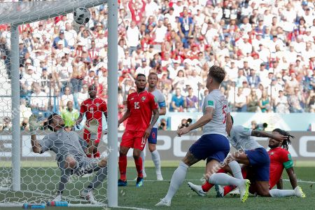England's John Stones, third from right, scores past Panama goalkeeper Jaime Penedo his side's fourth goal during the group G match between England and Panama at the 2018 soccer World Cup at the Nizhny Novgorod Stadium in Nizhny Novgorod, Russia