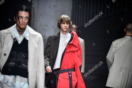 Stock Picture of Models present creations from the Spring/Summer 2019 Men's Collection by Dutch designer Lucas Ossendrijver for Lanvin during the Paris Fashion Week, in Paris, France, 24 June 2018. The presentation of the Men's collections runs from 19 to 24 June.